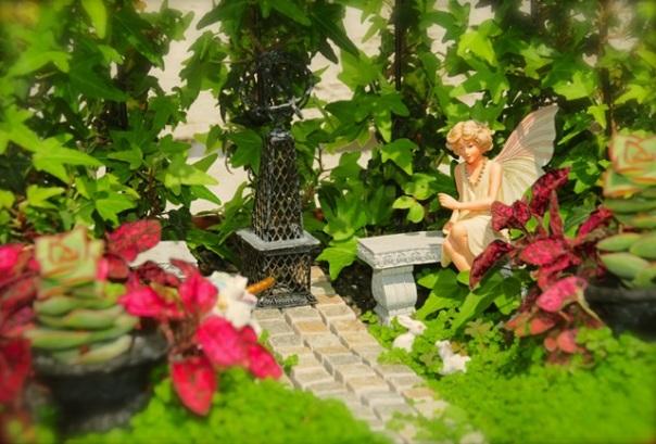 fairy-sitting-in-garden